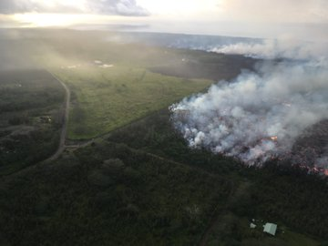 Photo from a 6:30 AM HST overflight of a lava flow from fissure 8 approaching the intersection of Pohoiki Road and Highway 132.