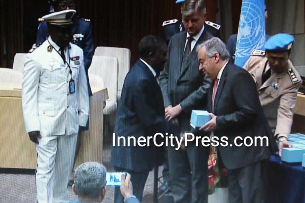 Here UNSG @AntonioGuterres at UN Peacekeepers' event with Ambassador of #Cameroon, whose troops are burning villages and killing civilians in the Anglophone zones. Inner City Press was banned from this event, while someone else is covering it with smart phone. #UN