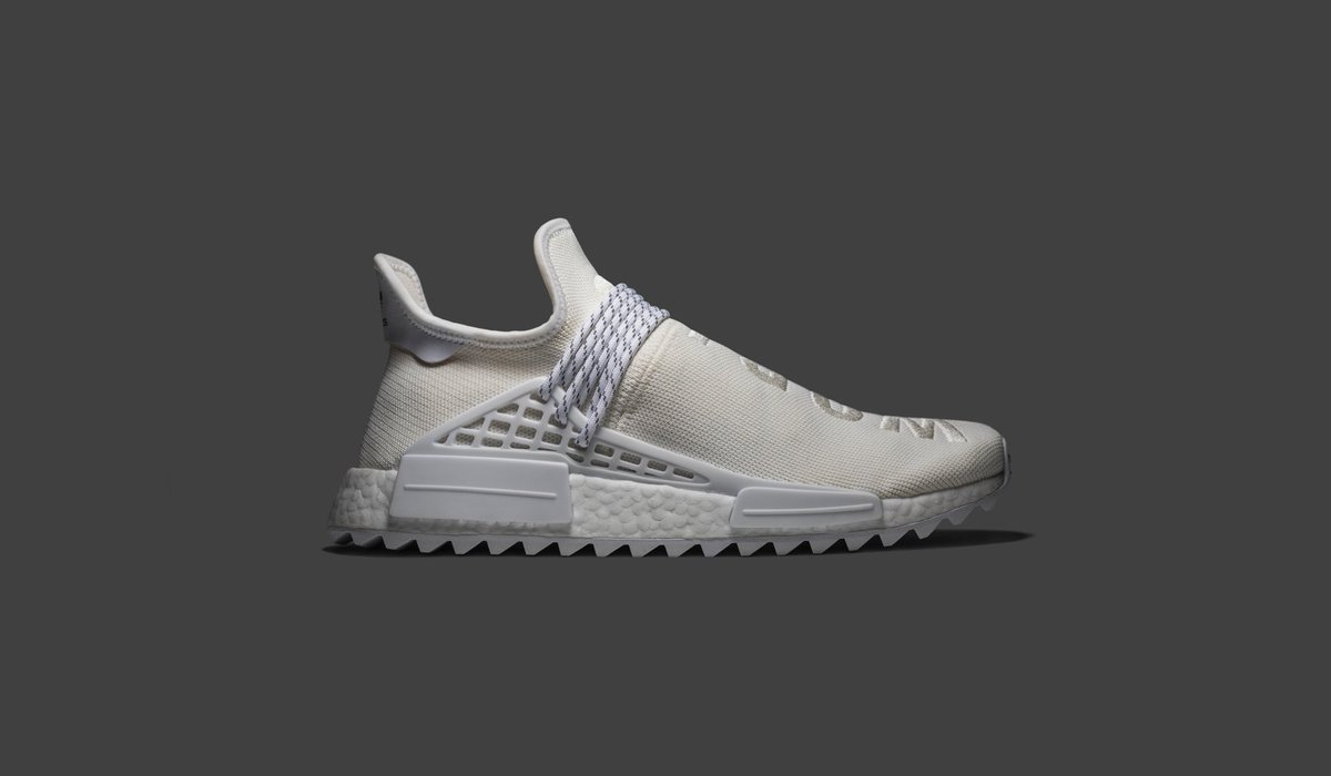 82b485db47ca8 This Pharrell x NMD Trail Holi  Human Race  colorway has a simple white  knitted upper. Available on the app and http   goat.com ...