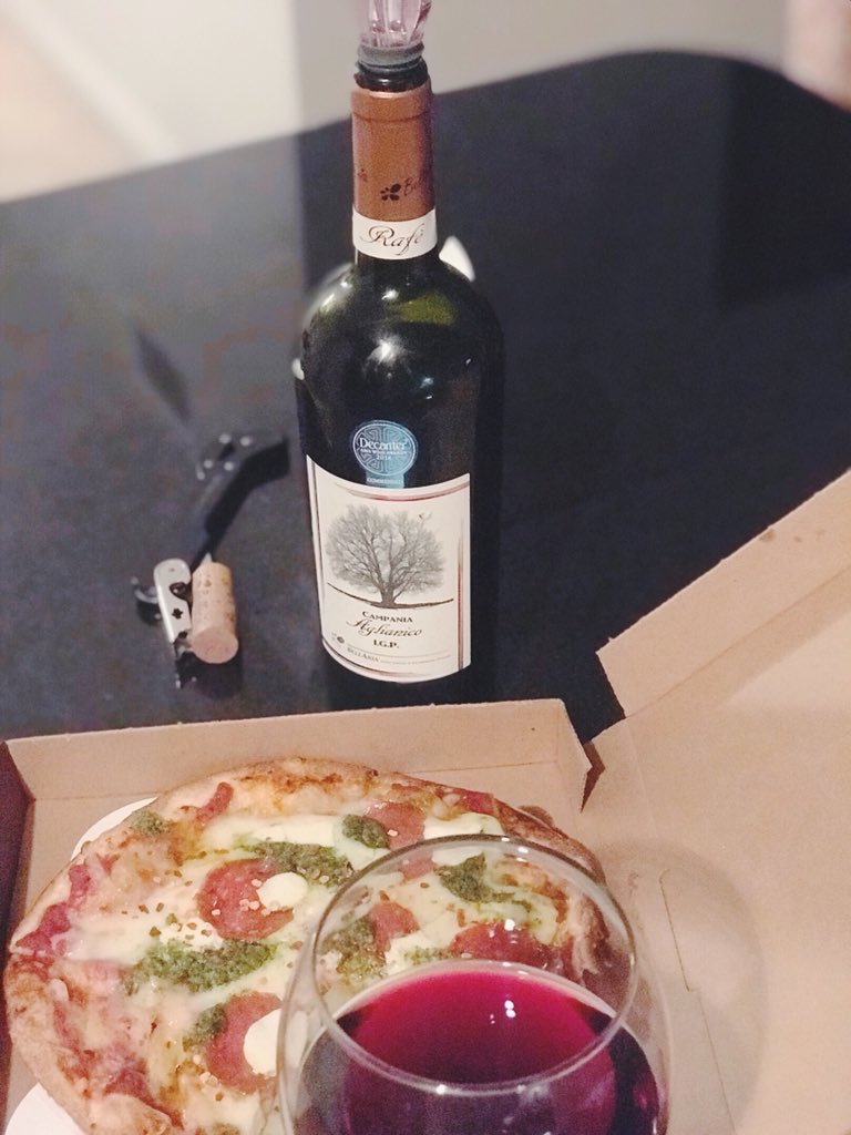 """A Perfect Pairing"". Aglianico with Malawis Pizza.100% Aglianico grapes.  Full bodied,balanced.Fruit cherry nuances,spicy notes of vanilla,cinnamon  on nose ..."