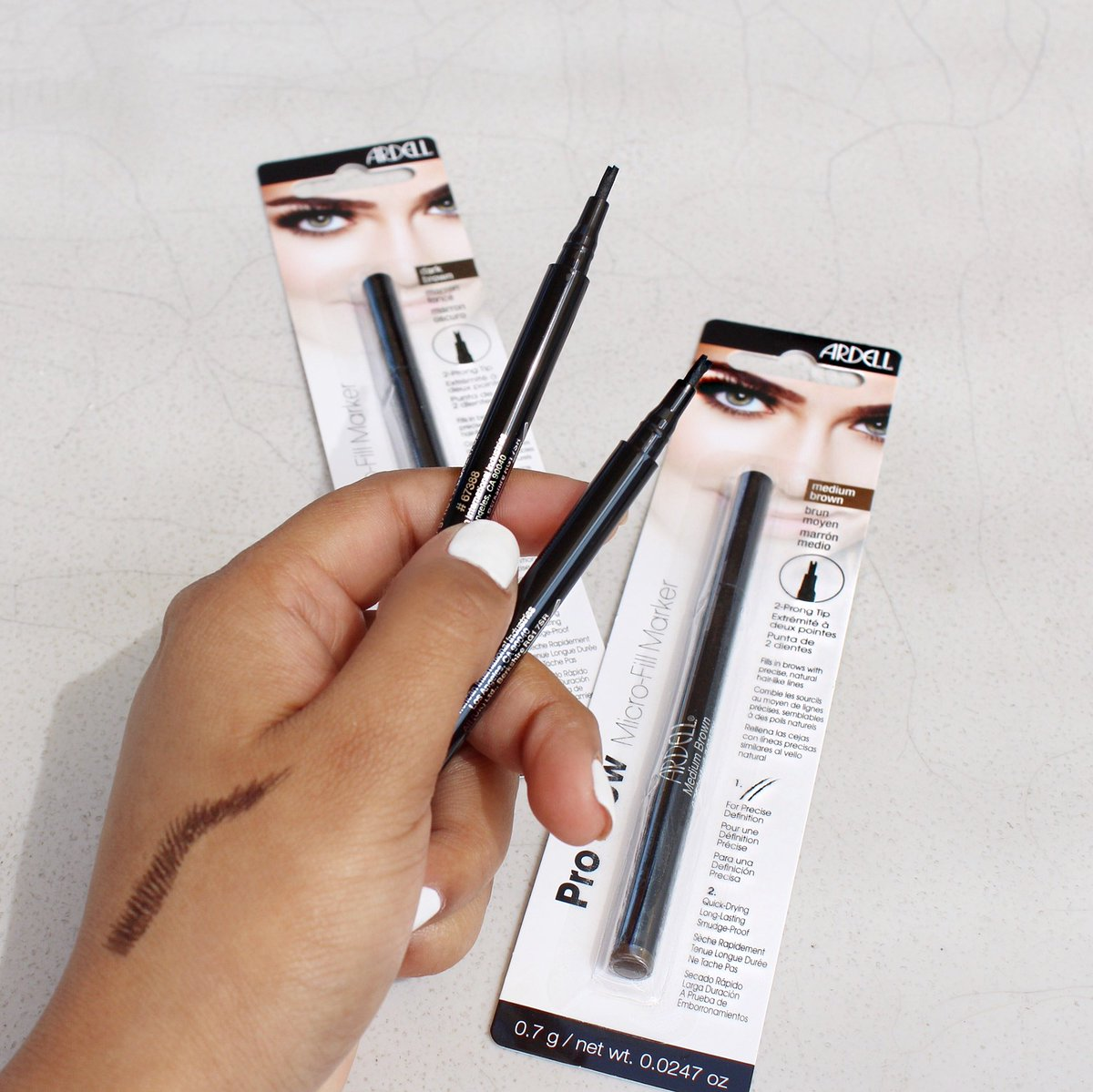 74f0caaed1a Try our Brow Micro-Fill Marker! This brow product has a smudge-proof  formula that clings to both skin and hair! Current shades: Medium Brown & Dark  Brown.