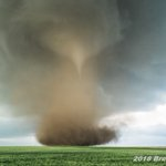 Image for the Tweet beginning: #weatherpicofday dusty cone tornado over