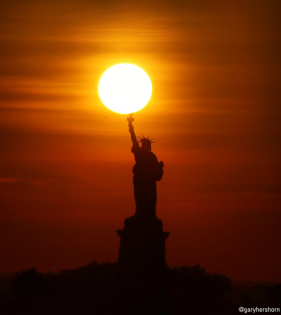 On this day in 1885, the Statue of Liberty, seen here tonight during sunset, arrived in the New York Harbor after being shipped across the Atlantic Ocean in 350 individual pieces. Lady Liberty was sent to the United States as a gift of friendship from France.