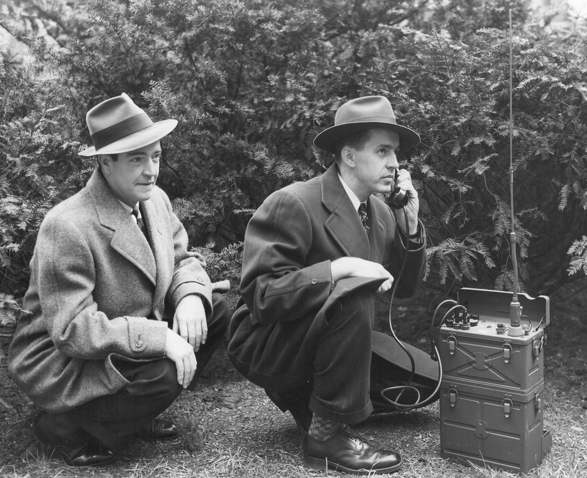 #TBT Two special agents on a stakeout with a field phone during a kidnapping case in the 1930s.