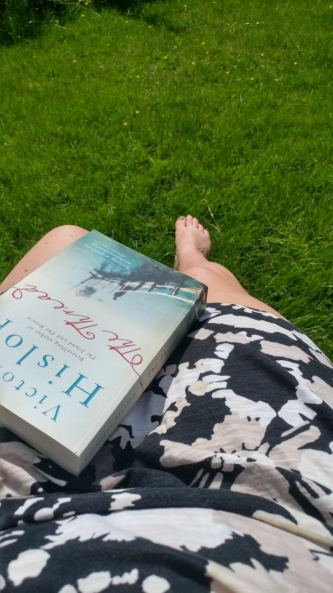 Reading my book and catching some sun makes me happy....