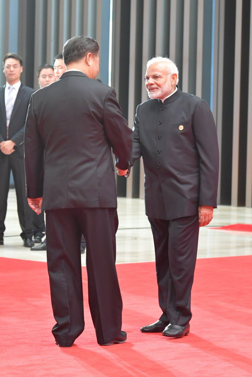 PM @narendramodi meets Chinese President #XiJinping at the welcome ceremony of Shanghai Cooperation Organisation (SCO) Summit in #Qingdao #China #SCOSummit2018 <br>http://pic.twitter.com/ftcUuMIwHL
