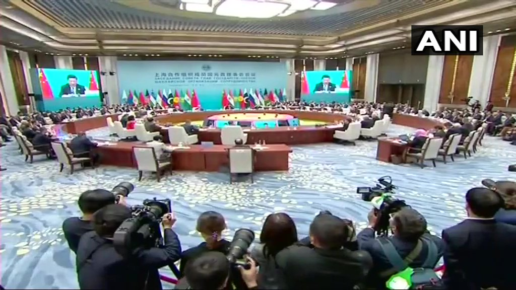 Plenary session of #SCOSummit2018 underway in China&#39;s #Qingdao. PM Narendra Modi and Russian President Vladimir Putin also present<br>http://pic.twitter.com/8WOivhM8qg