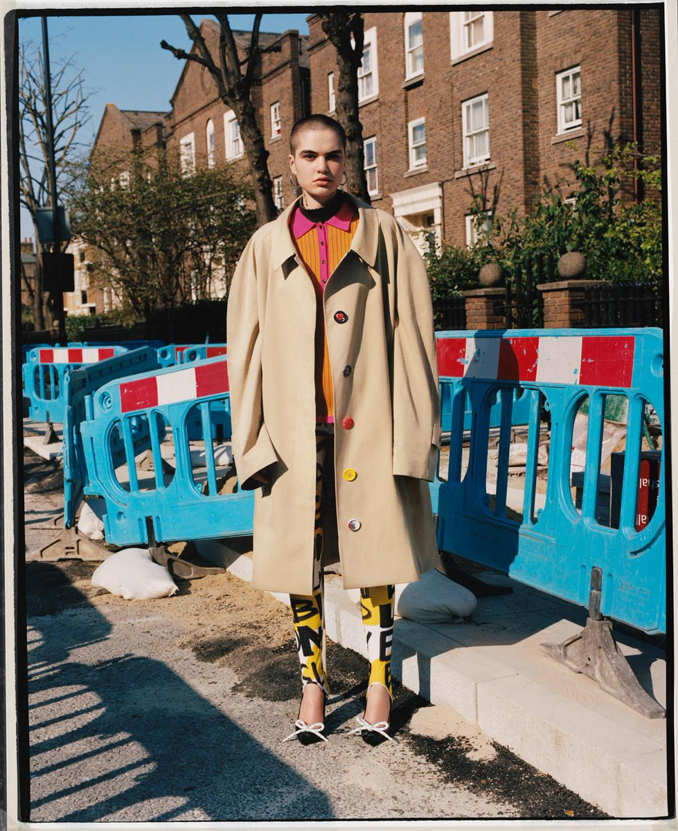 Misha wears a two-tone polo shirt with graffiti-print leggings and a tropical gabardine car coat. Our new Autumn/Winter Pre-Collection, captured on location in London in a #BurberryPhotoSeries by Laurence Ellis brby.co/71j