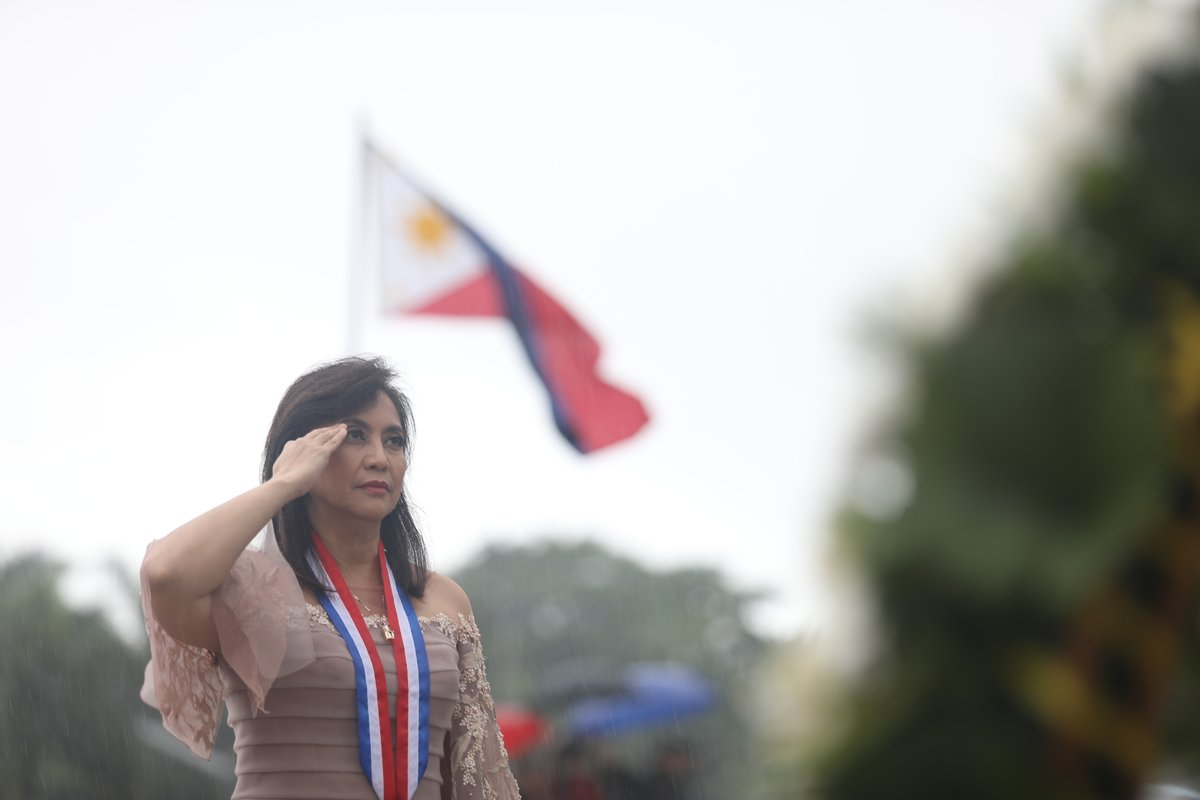 LOOK: VP Leni Robredo, drenched in rain, honors the Philippine flag on Independence Day | OVP photos via @maracepeda