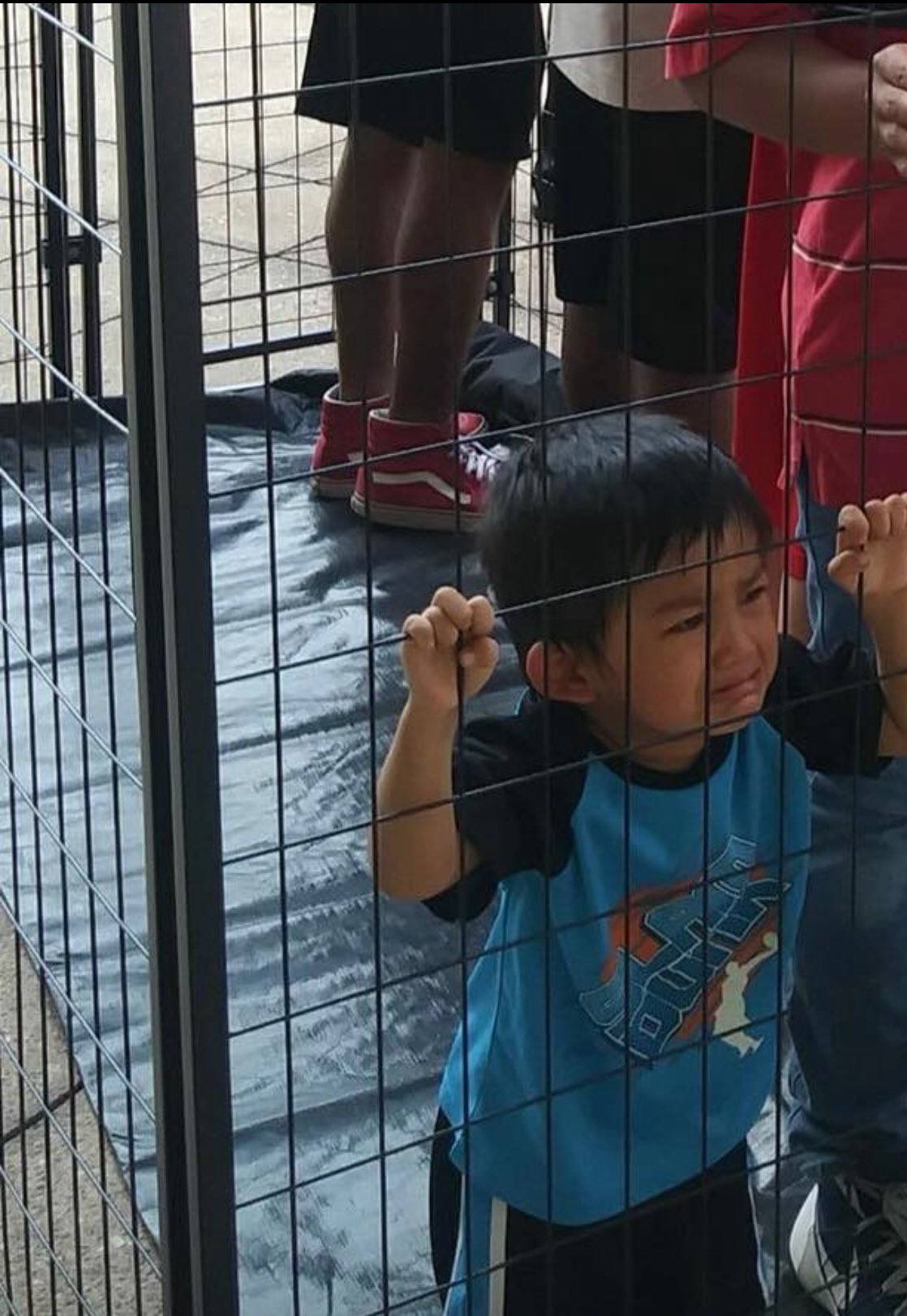 """This is what happens when a government believes people are """"illegal.""""  Kids in cages. https://t.co/OAnvr9cl3P"""