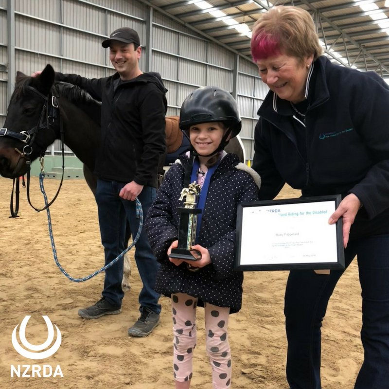 #DWTSNZ @NewshubNZ presenter @SamHayes_ is dancing for riders like 8-yr-old Ruby from #Christchurch. Ruby is NZRDA Rider of the Year & got her award from RDA coach Chrissy, #volunteer Michael & #therapy #horse Gypsy. Go Ruby! #NZRDA #TeamSam #ReachingMoreRidersChangingMoreLives https://t.co/bM9k1dnW3e