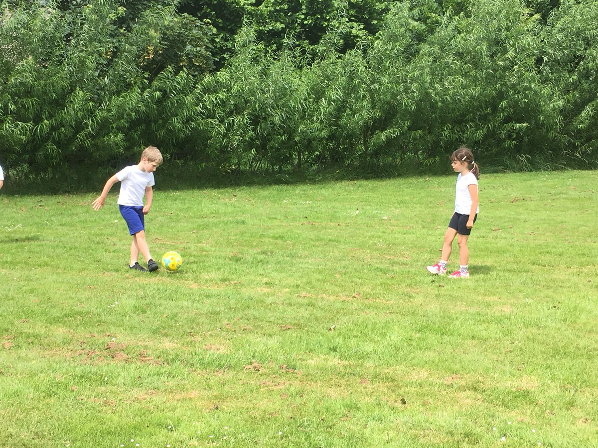 Year 1 are getting into the World Cup spirit with skill work in PE this afternoon #worldcup2018 #football