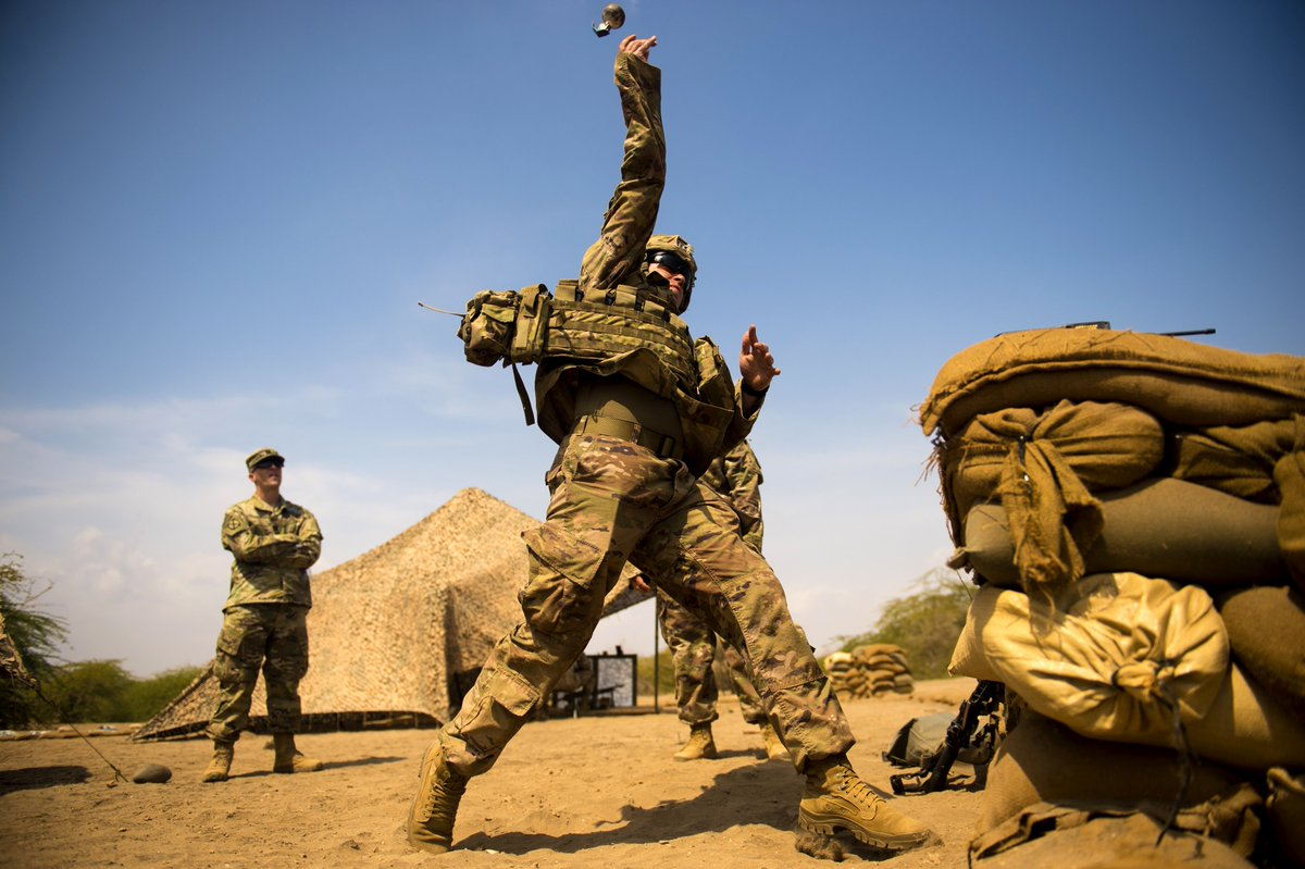 a2aadbe20 sgt james killgore 10th mountain division infantryman lobs a dud grenade  during a training event in