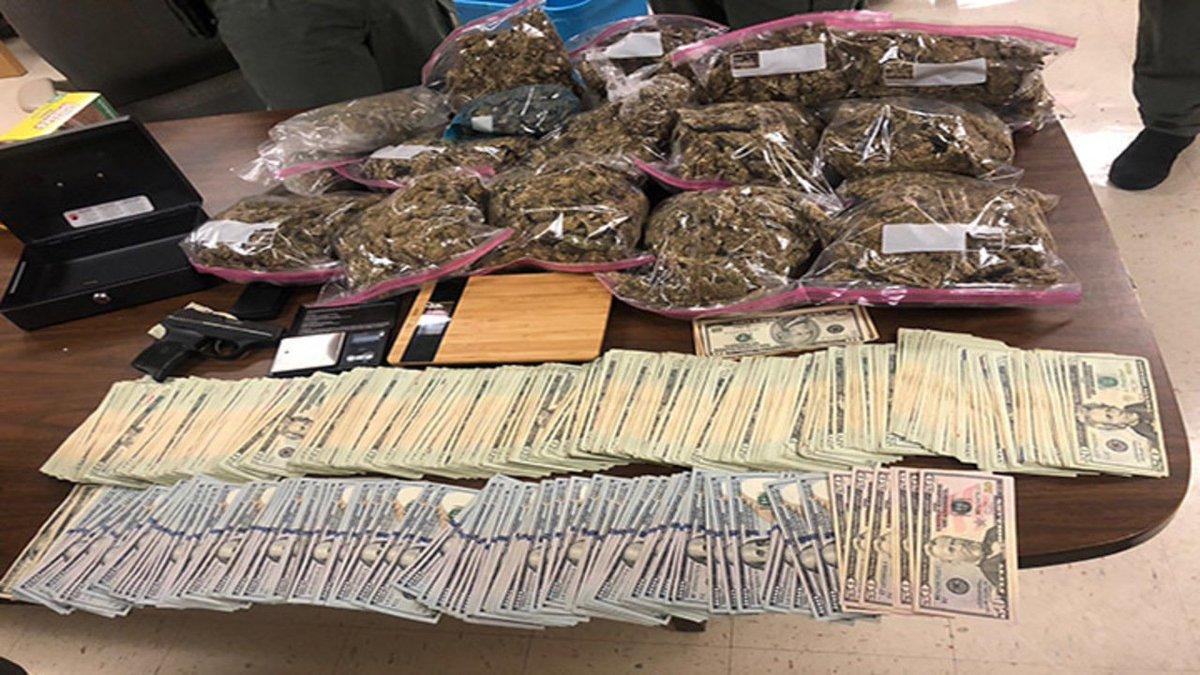 Over 14 Lbs  of Marijuana, Stolen Firearm Seized in