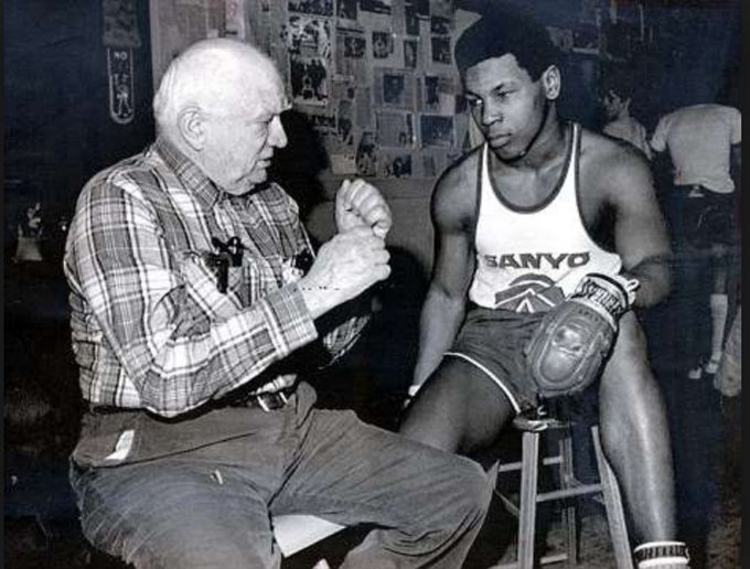A happy birthday to Mr. Mike Tyson, shown here as a young teen with the great Cus D\Amato.