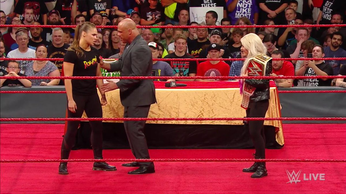 Did @RondaRousey just go TOO FAR in destroying @AlexaBliss_WWE's championship celebration on #RAW?!