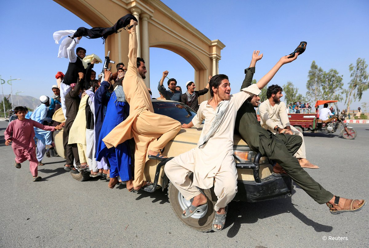 People celebrate ceasefire with the Taliban in Rodat district of Nangarhar province, Afghanistan on the weekend. After the three-day ceasefire came to an end, Taliban attacks in the northern Faryab province and near Kabul left at least 6 policemen dead and 4 injured.