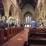 Image for the Tweet beginning: Parishioners praying at midday mass