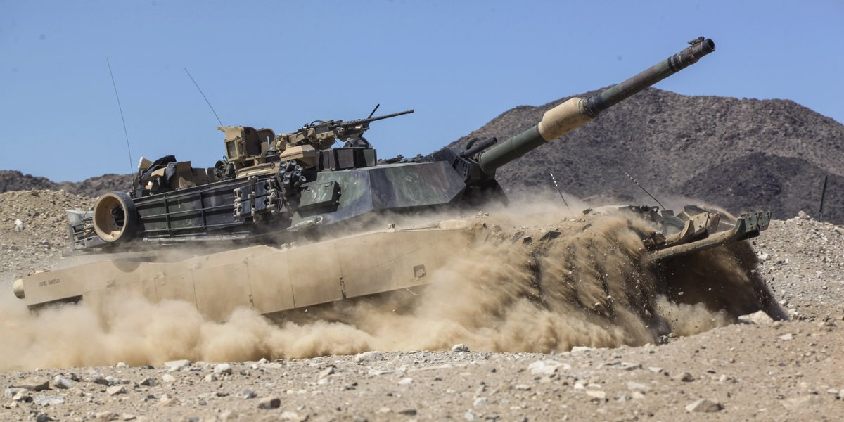 Gangway Marines clear an obstacle with an M1A1 Abrams main battle tank @CombatCenterPAO.