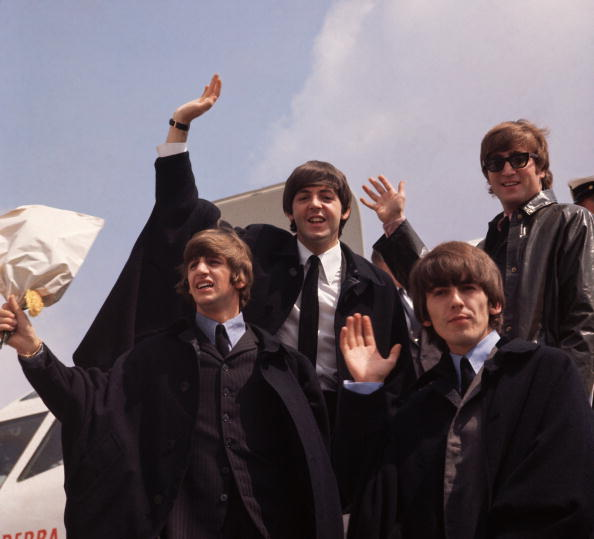 The #Beatles pictured on their arrival in London following their tour in Australia, 2nd July 1964 Photo