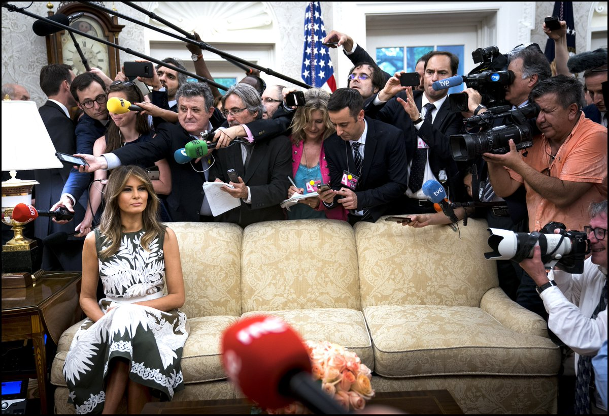 Photo Of Melania Trump Sitting Alone On A Couch Surrounded By Photographers Goes Viral