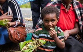 This Southern Highlands toddler doesn't know the 75% of that healthy meal from home grown foods hes enjoying is great for healthy brain development. UNICEF is teaching his community to prepare nutritious meals from readily available local foods to promote nutrition in children.