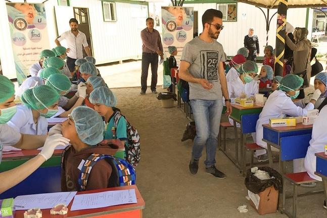 Children receiving dental care at a school