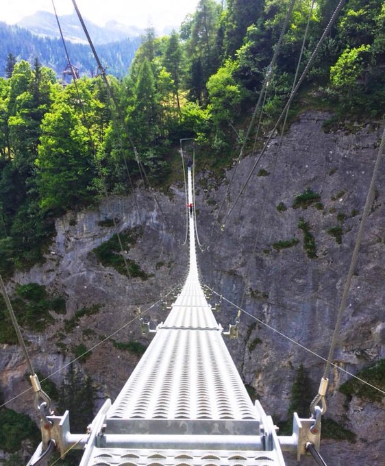 """""""On Saturday, we braved the K3 Via Ferrata in Murren, Switzerland with two of our good friends. At the end of the 4-hour thrill-filled excursion hangs this wobbly Nepal bridge over a 750-foot valley."""" SCF subscribers and Instagram user outrighttravel #TravelTuesday🇨🇭 😯 Photo"""