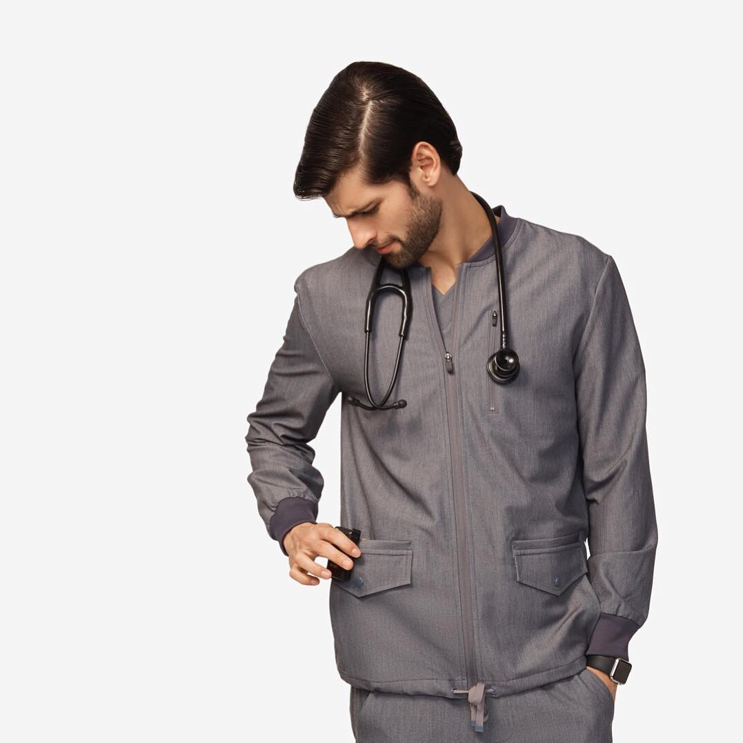 c60dc6290b1 A man needs pockets and our bomber-inspired Vintar scrub jacket has SEVEN.  It's cool. It's functional. It's comfy. Get one (or two or three!)! ...