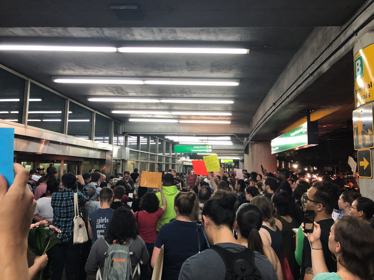 """""""This is what solidarity looks like."""" Right now at LaGuardia. Our tax dollars have funded the terrorization of families seeking refuge. Let's keep showing up people #FamilesBelongTogether"""