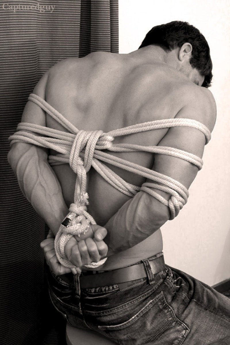 Bondage thumbs hands tied rope