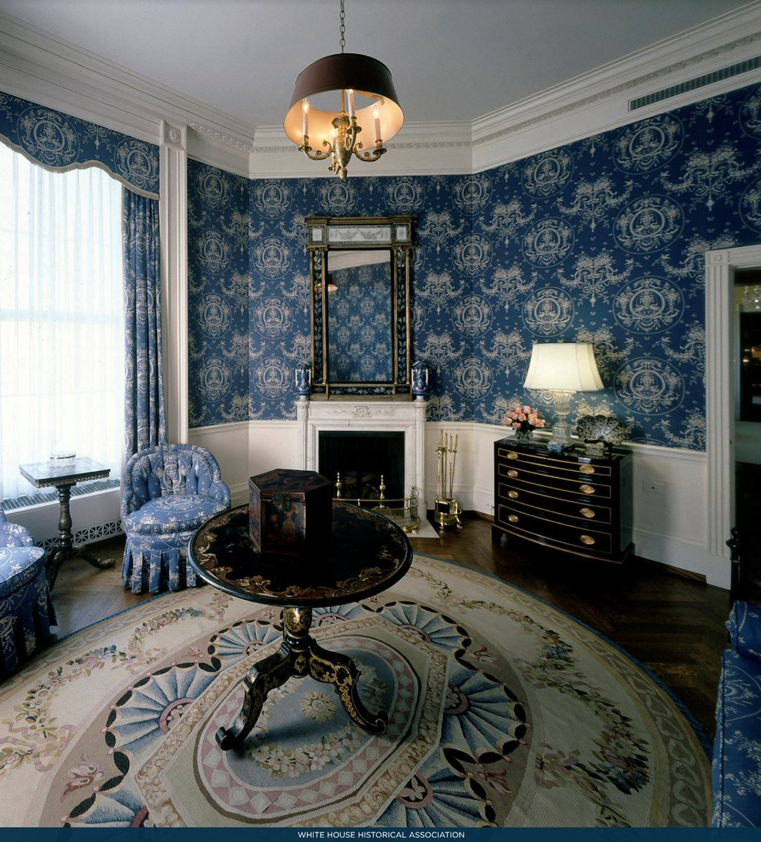 From 1962-1963, First Lady Jacqueline Kennedy redecorated the room, adding the dark blue and white cotton wallpaper and black and gold ...