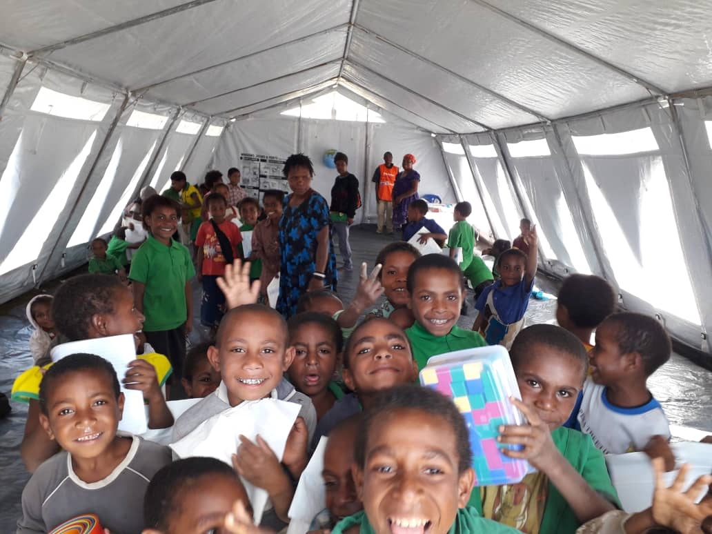 Smiley faces in a Safe Temporary Learning Space in Southern Highlands Province. These children affected by the February's Earthquake received education supplies from UNICEF who also trained teachers to give psycho-social support. @rightsforthem #unicefpng