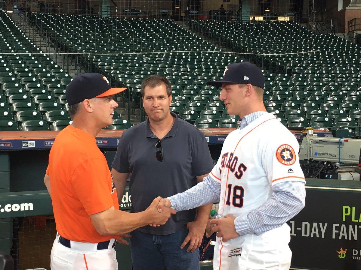Astros second-round pick RHP Jayson Schroeder meets manager AJ Hinch.