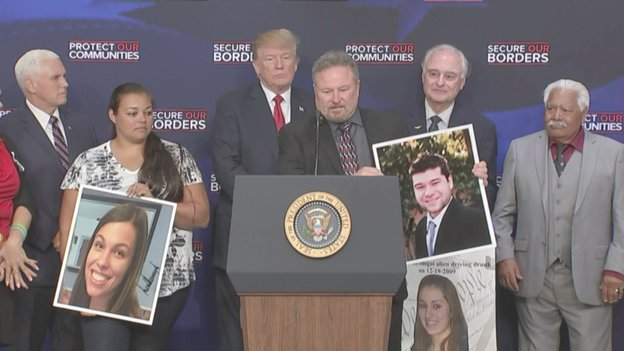 Don Rosenberg holds photo of his 25-year-old son Drew, killed in 2010 in a car accident allegedly caused by individual who entered the US illegally.  Rosenberg says he's fighting Sanctuary State status in California.