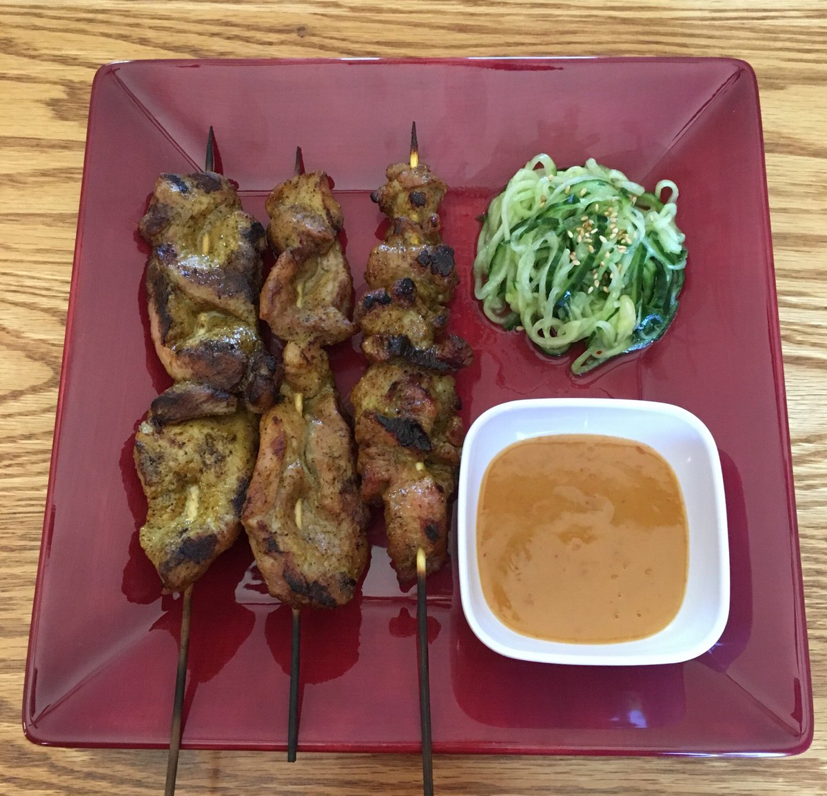 Street vendor pork satay & peanut sauce (made with soy butter due to allergies) with a side of spiralized cucumber salad. OMG! @jettila these are the bomb!! Recipes # 10 & 11 we've made from your cookbook. Still not disappointed. #101AsianDishes #youcanteatjustone<br>http://pic.twitter.com/SHWkUB4Y0G