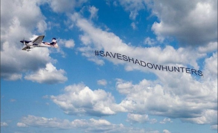 Fans discussing about Shadowhunters Fan 1 : Guys we need to make more noise Fan 2 : Yes we need to let Netflix know we arent giving up! Fan 3 : if we could Make a plane fly above Netflix HQ just for few hours Fan 1 and 2 : 🤔 🤔🤔🤔 DONE! #SaveShadowhunters #ShadowhuntersPlane