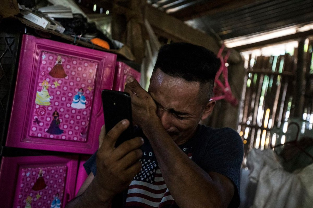 """This photo. A father deported to El Salvador without his daughter talks to her over the phone. She's calling from a shelter somewhere in the United States.   """"Papa,"""" she said. """"When are you going to take me out of here?"""""""