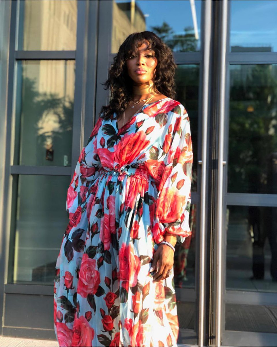 Naomi Campbell blossoms with beauty in this Dolce&Gabbana rose printed dress. #DGWomen #DGCelebs @NaomiCampbell
