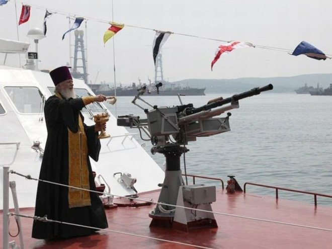 Image result for orthodox priest blessing weapons