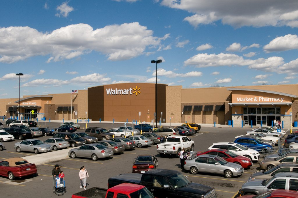 Walmart shopper wrestles gun from security officer begins shooting during customers fighting