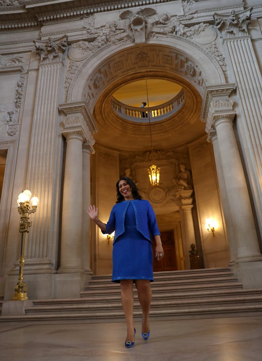 London Breed is handed the reins for her reign as #SFMayor and wears royal blue, often a symbol of calm, harmony and intelligence. It's also said to be the least-disliked color across cultures.  The knit dress & sweater are serious & polished, but not stiff.