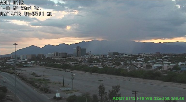 Enjoy this great shot of downtown #Tucson with a rain shaft in the background.