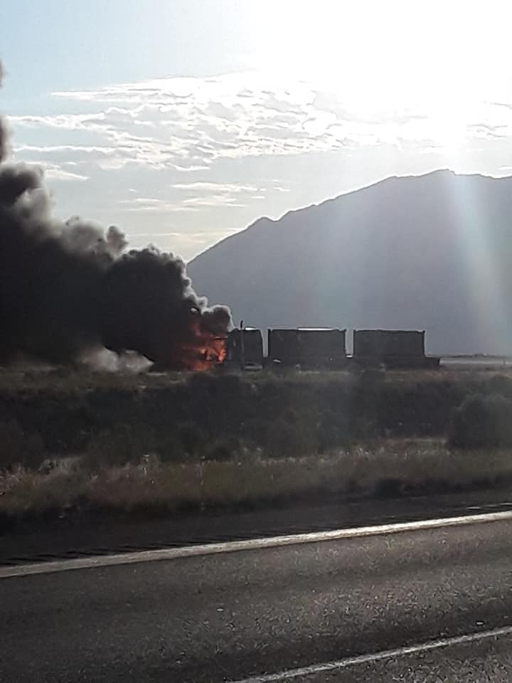 BREAKING: Images of the truck that caught fire in on WB I-80 in Tooele County near Lake Point. The truck is carrying radioactive dirt. (Photos: Shawn Richard) #breaking #utah #kslam @KSL5TV #tooelecounty @newsyCaitlin @TCEM<br>http://pic.twitter.com/cUkJKaP3a5