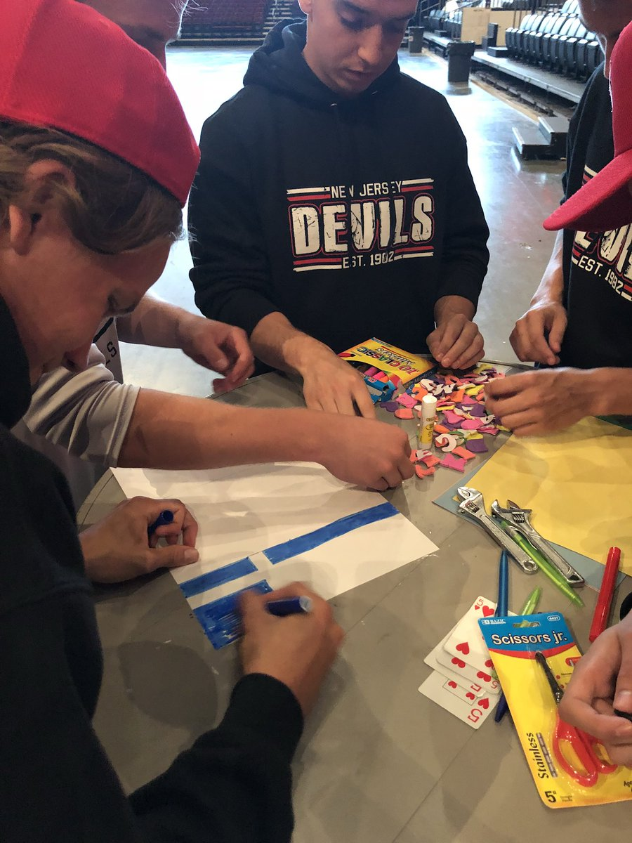 Before the bike building can begin, a couple team building events... divided into groups of five, they have to come up with a team name, create a flag and a team cheer. #NJDevCamp #artsandcrafts @NJDevils #NJDevils