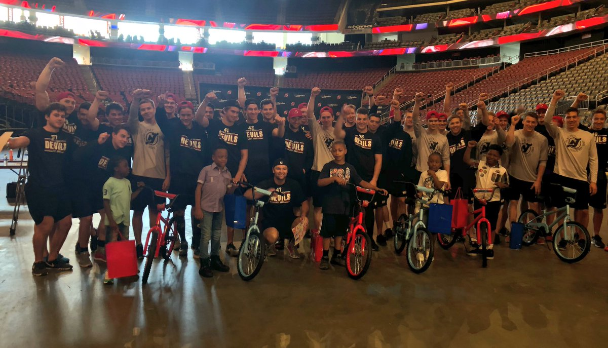 After a build-a-bike community event, the #NJDevCamp prospects give their finished products to local youth!