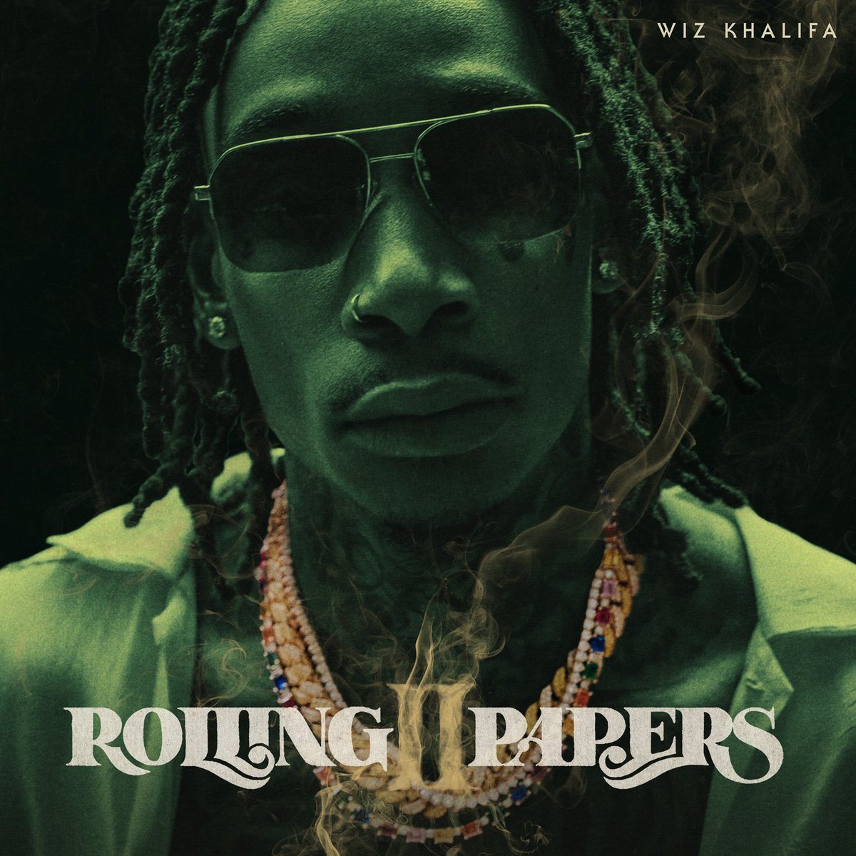 Roll UP & GO STREAM ROLLIN PAPERS 2 NOW!  #TGOD! @wizkhalifa