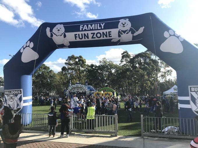 KICK off for #NRLBulldogsSouths is 3pm tomorrow, but the @NRL_Bulldogs Family Fun Zone is open from 1pm! Get here early & enjoy jumping castles, VR booths & obstacle courses. Remember #FansFirst means 4 kids get in FREE on 1 Adult ticket. More info: Photo