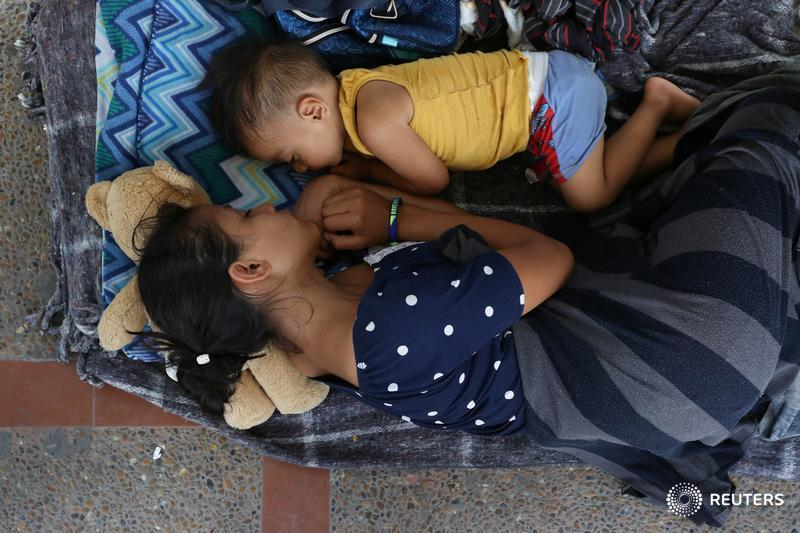 A 17-year-old Honduran mother seeking asylum with her 2-year-old son waits in Mexico after being denied entry by U.S. Customs and Border Patrol in Texas