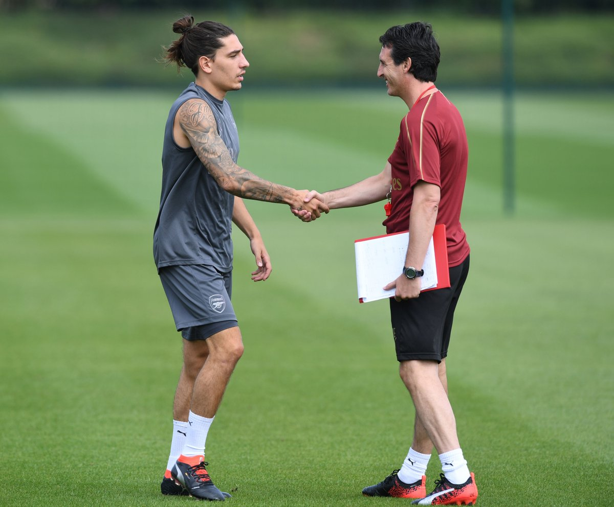 First day of pre-season training without Arsene Wenger. Hector Bellerin meeting new Arsenal manager Unai Emery. #PremierLeague